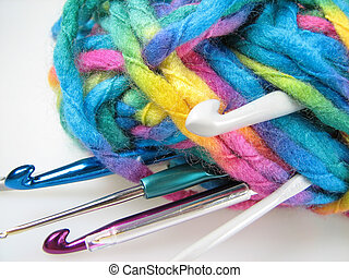 Bale of yarn for knitting with different sizes of crochet...