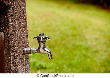 Spigot - A outdoor spigot ready to spit out water.