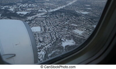 Toronto winter approach 1 of 2 - Commercial jet flying over...