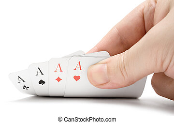 Revealing Four Aces - Fingers holding four aces Isolated on...