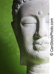 Statue of Buddha - Closeup of the face of a beautiful...