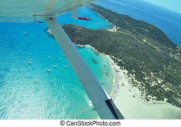 flying on top of the paradise - the beach from the plane