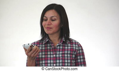 Woman With Two Cellulars - Woman with two cell phones looks...