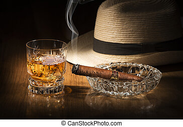 Whiskey and cigar - Cuban style rum and cigar close up