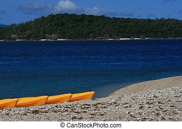 Kayaks on the Beach - Kayaks or canoes on the beach