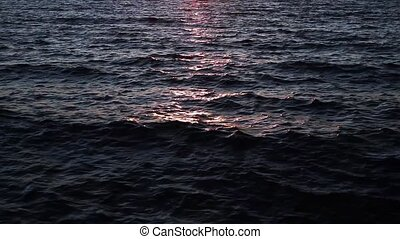 Sundown Waves Loop - Loop with sunlight shining and...