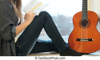 Girl Studying Guitar Fingerings - Teenager Girl Studying...