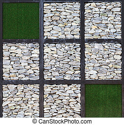 Modern art, block of rock wall and artificial grass