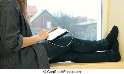 Teen Girl With Digital Tablet - Teenager girl surfing the...