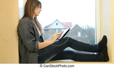 Listening Music On Digital Tablet - Teenager Girl Listening...