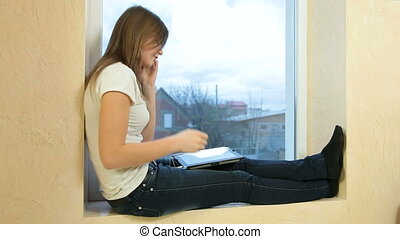Teen Girl With Digital Tablet And Smartphone At Home
