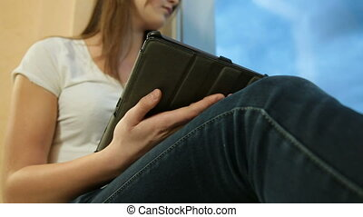 Teenager Girl Listening Music On Digital Tablet, Looking...