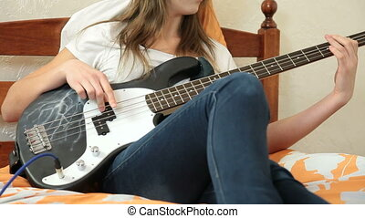 Girl Playing Bass Guitar At Home - Teen Girl Playing Bass...