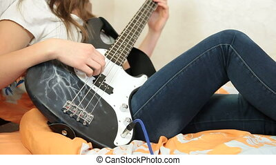 Teen Girl Playing Bass Guitar