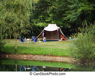 Camping by Lake - Tent in the woods near a lake