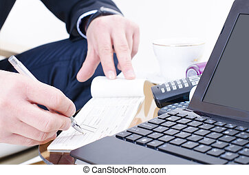 Bank Check - A business man writing a bank check