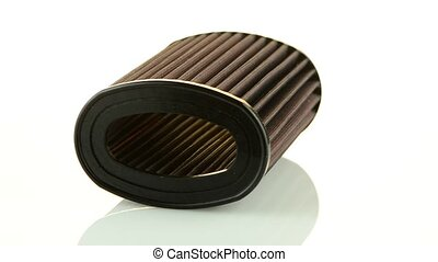 Air cone filter rotating on white background. Vehicle...