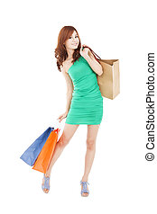 full length of happy asian woman with shopping bag - full...