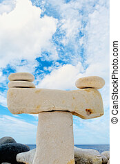 Statuesque - Stack of pebbles against the blue sky