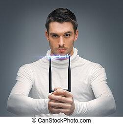 futuristic man with stun gun - bright picture of futuristic...