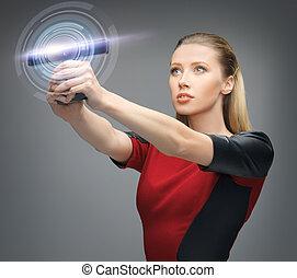 futuristic woman with gadget - bright picture of futuristic...