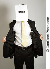 Broke businessman - Businessman with empty pockets and a...