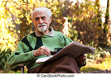 Elderly man reading the paper - Elderly man reading the...