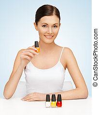 woman with nail polish bottles - picture of beautiful woman...