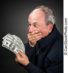 elderly man with fan of dollars