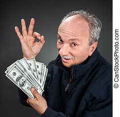 elderly man showing fan of money - Happy elderly man showing...