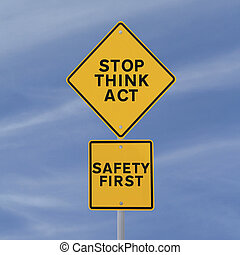 Stop Think Act - A road sign with a safety reminder or...