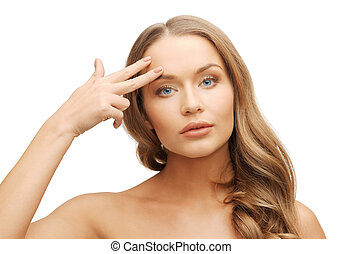 beautiful woman pointing to forehead - picture of beautiful...