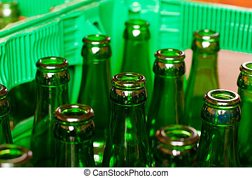 Crate with empty beer bottles - A crate of empty beer...