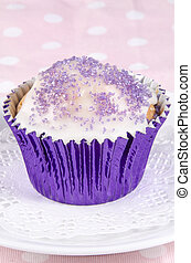 cupcake with icing and lilac sprinkles
