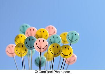 Smiley face on blue sky background