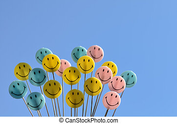 Smiley face on blue sky background.