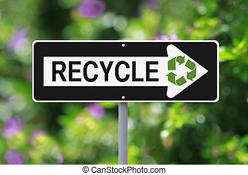 Green Road Sign - A modified one way sign on recycling with...