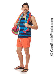 Man in Swimwear - Young man in swimwear. Studio shot over...