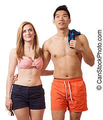 Young Couple in Swimwear - Young couple in swimwear Studio...