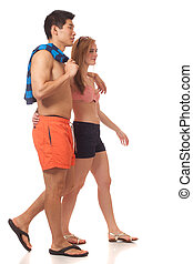 Young Couple in Swimwear - Young couple in swimwear. Studio...