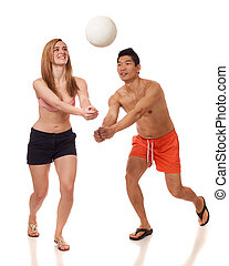 Young Couple Playing Volleyball - Young couple playing...