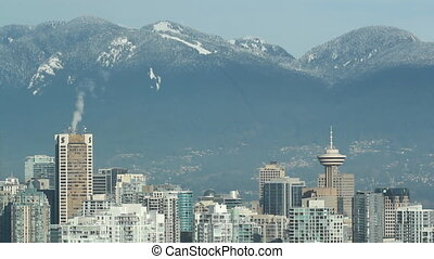 Vancouver skyline with tall towers.