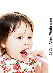 Child brushes teeth - Little girl enjoys brushing her teeth