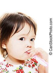 Toddler brushes teeth - Young girl brushing teeth closeup...
