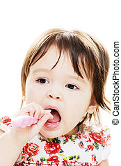 Infant cleans teeth - Young girl enjoys brushing her teeth...
