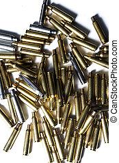 empty rifle cartridges on white backgroiund