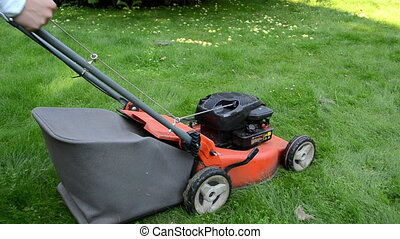 worker start grass mower - man gardener worker start grass...