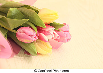 Tulips on a table - Closeup of tulips on a wooden table