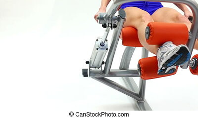 Closeup of woman on hydraulic exerciser. White background