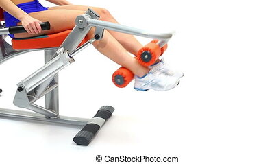 Closeup of young woman on hydraulic exerciser. White...